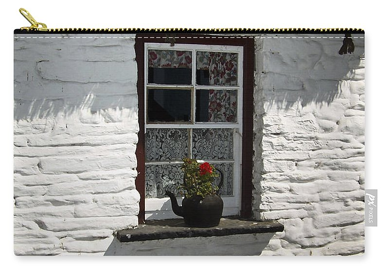Irish Carry-all Pouch featuring the photograph Irish Kettle Of Geraniums County Cork Ireland by Teresa Mucha