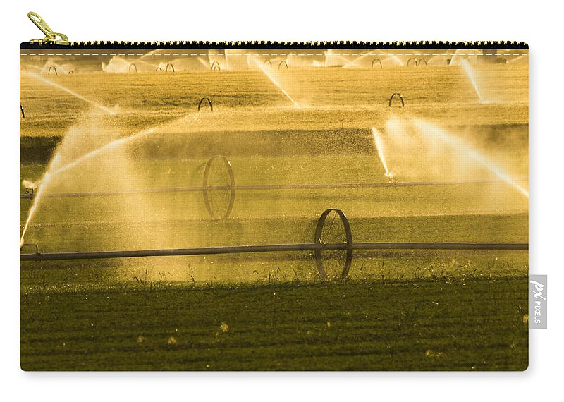 Agriculture Carry-all Pouch featuring the photograph Irrigation System Operating At Sunset by John Trax