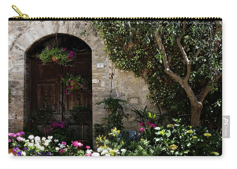 Flower Carry-all Pouch featuring the photograph Italian Front Door Adorned with Flowers by Marilyn Hunt