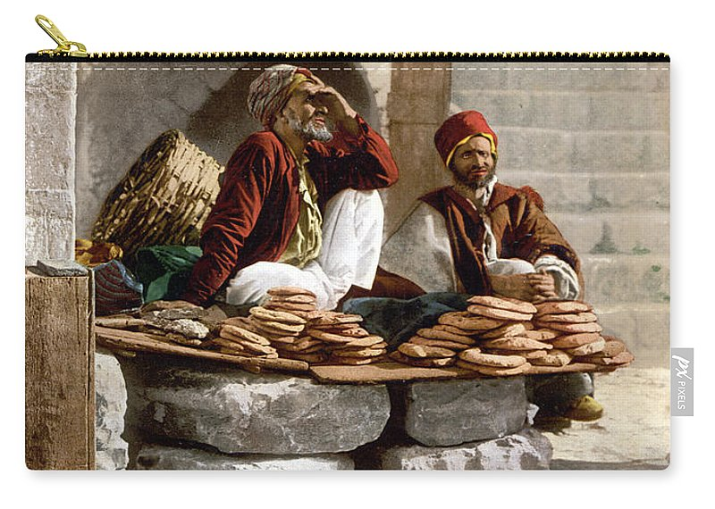 Jerusalem Carry-all Pouch featuring the photograph Jerusalem - Bread Seller by Munir Alawi