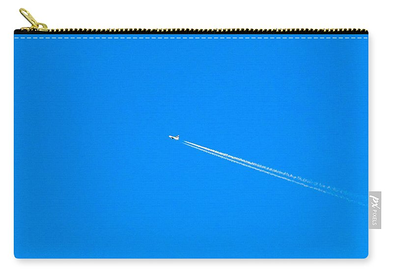 Jet Carry-all Pouch featuring the photograph Jet Going By At Sunset by William Tasker