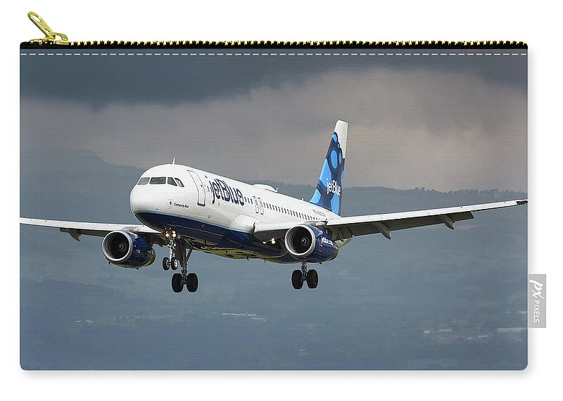 Jetblue Airways Airbus A320 Landing San Jose Costa Rica Mroc Sjo Aviation Airplane Landing Carry-all Pouch featuring the photograph jetBlue A320 landing with mountain by Andres Meneses