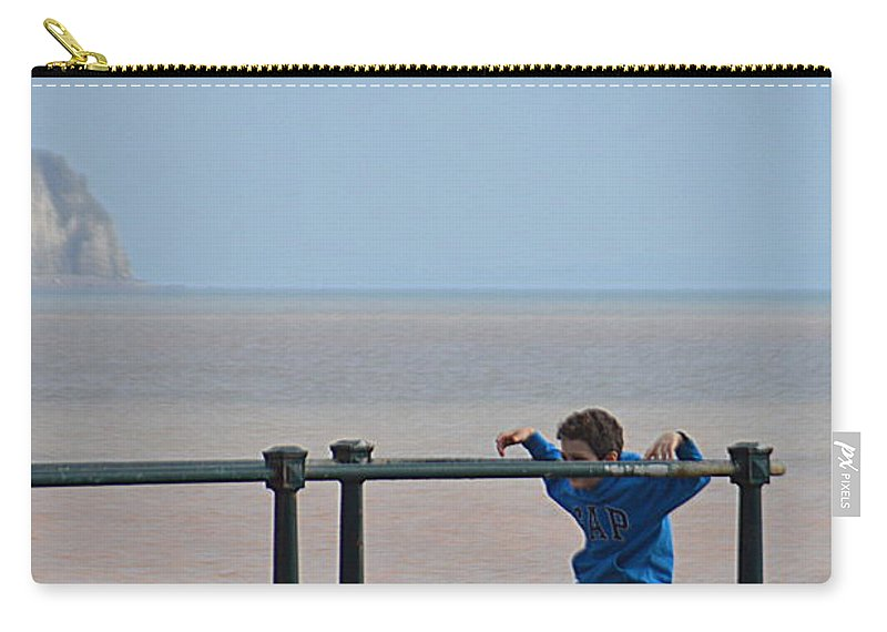 Railings Carry-all Pouch featuring the photograph Kid and Railings by Andy Thompson