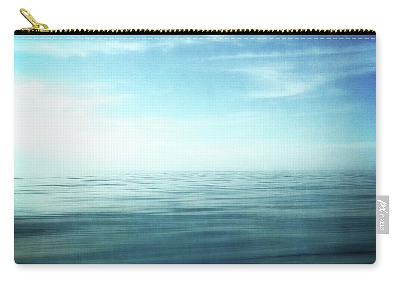 Blue Sky Carry-all Pouch featuring the photograph Lake And Sky by Michelle Calkins
