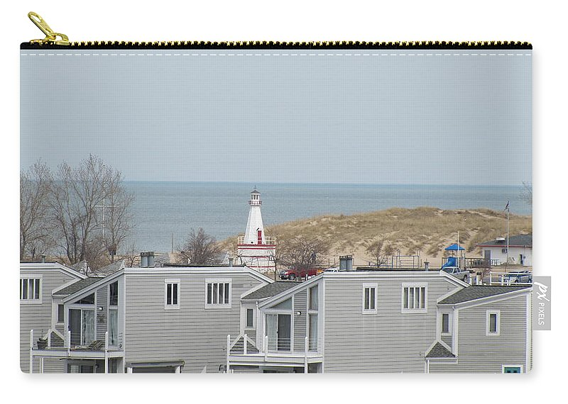 Lakeside Lighthouse Carry-all Pouch featuring the photograph Lakeside Lighthouse by Michael TMAD Finney