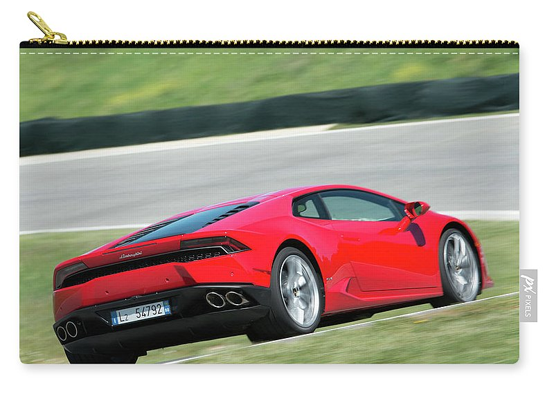 Lamborghini Huracan Carry-all Pouch featuring the photograph Lamborghini Huracan by Jackie Russo