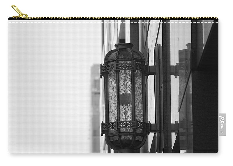 Architecture Carry-all Pouch featuring the photograph Lamp On The Wall by Rob Hans