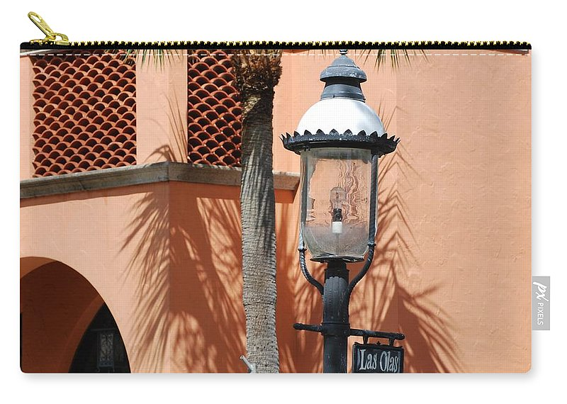 Lamp Posts Carry-all Pouch featuring the photograph Las Olas by Rob Hans