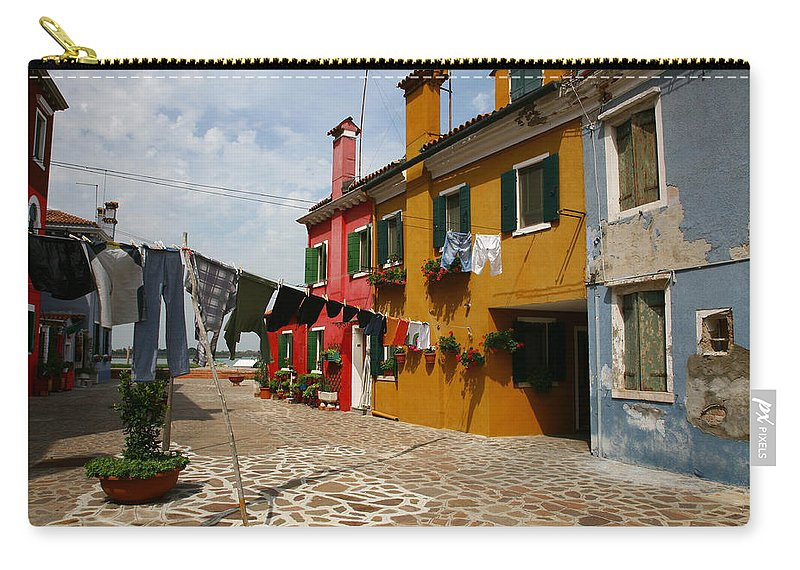Laundry Carry-all Pouch featuring the photograph Laundry Held By Wooden Pole by Donna Corless
