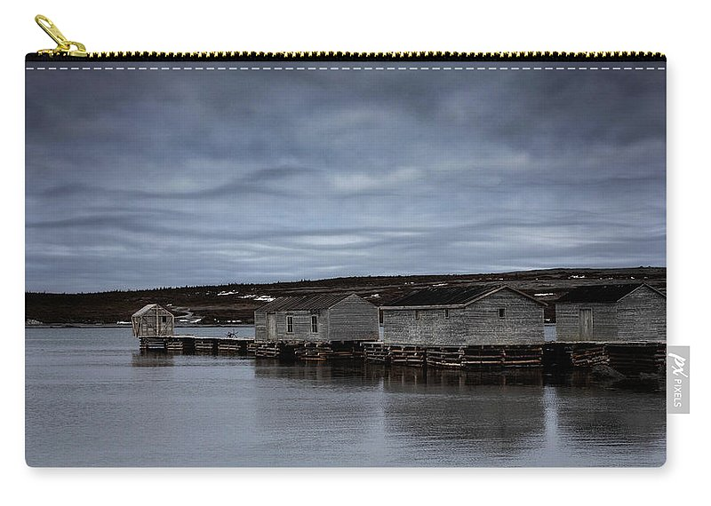 Canada Carry-all Pouch featuring the photograph Leaden Sky Over Shacks by Linda Cullivan