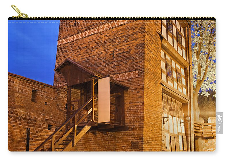 Leaning Carry-all Pouch featuring the photograph Leaning Tower By Night In Torun by Artur Bogacki