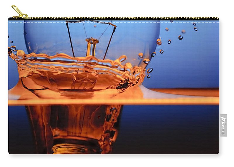Alternative Carry-all Pouch featuring the photograph Light Bulb And Splash Water by Setsiri Silapasuwanchai