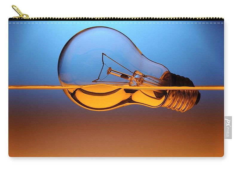 Alternative Carry-all Pouch featuring the photograph Light Bulb In Water by Setsiri Silapasuwanchai