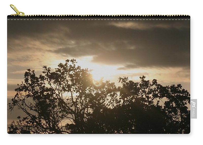 Light Carry-all Pouch featuring the photograph Light Chasing Away The Darkness by Nadine Rippelmeyer