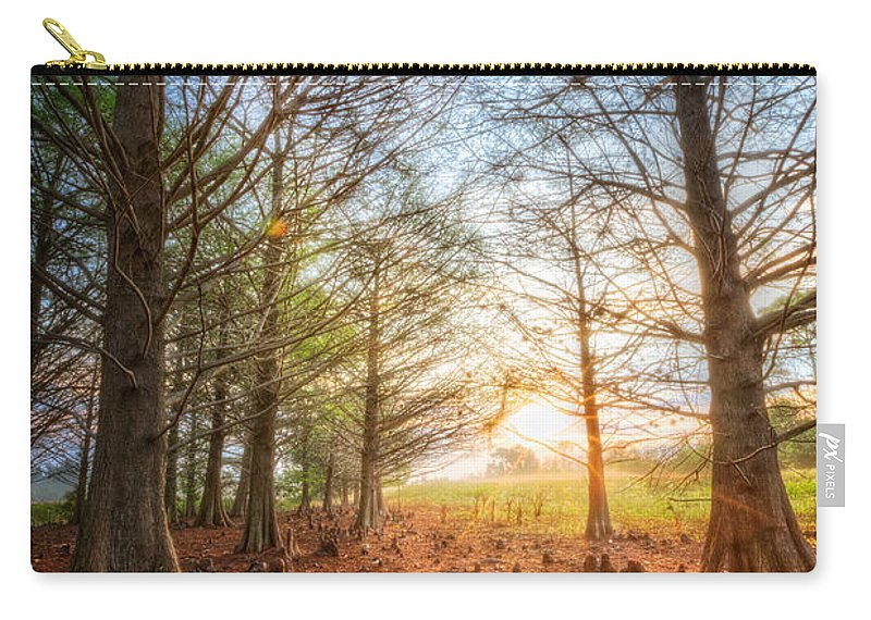 Everglade Carry-all Pouch featuring the photograph Light In The Cypress Trees II by Debra and Dave Vanderlaan