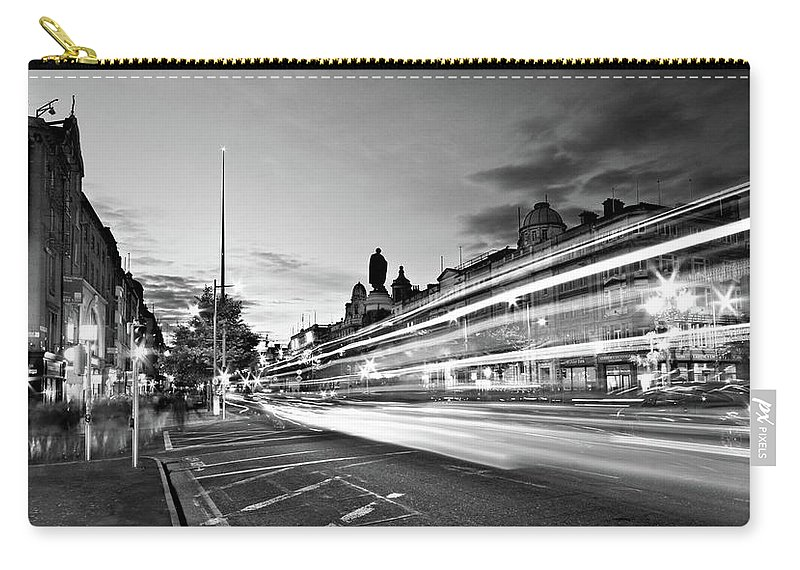 O'connell Street Carry-all Pouch featuring the photograph Light Trails On O'connell Street At Night - Dublin by Barry O Carroll