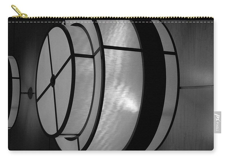 Black And White Carry-all Pouch featuring the photograph Lighted Wall In Black And White by Rob Hans