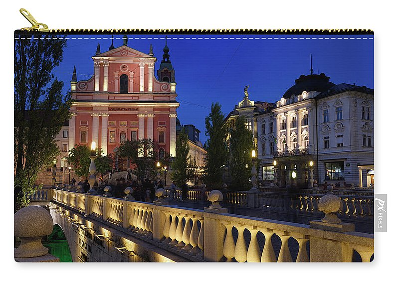 Pink Facade Carry-all Pouch featuring the photograph Lights On Pink Facade Of Franciscan Church Of The Annunciation A by Reimar Gaertner
