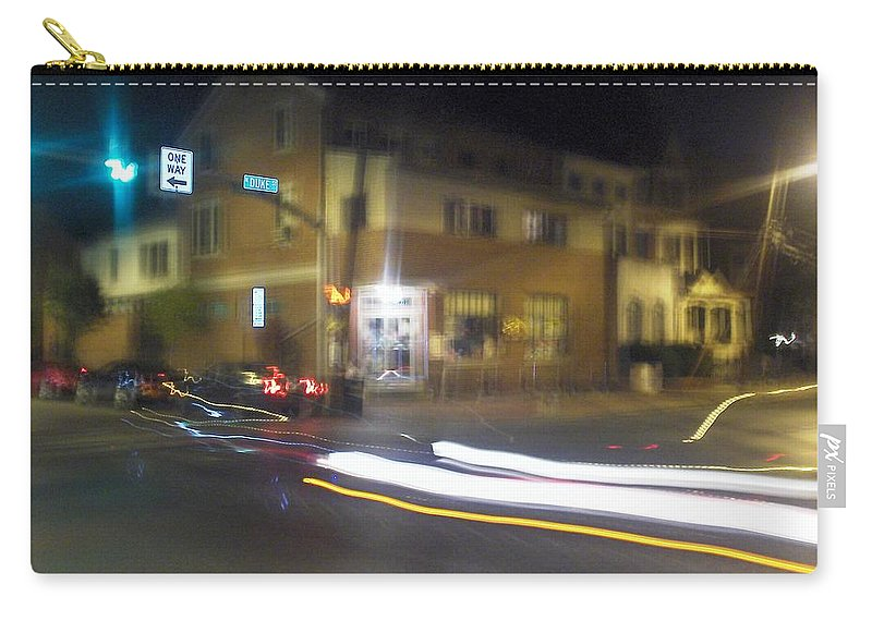 Photograph Carry-all Pouch featuring the photograph Lights That Race by Thomas Valentine