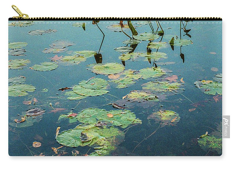 35mm Film Carry-all Pouch featuring the photograph Lilly Pad In Pond by John McGraw