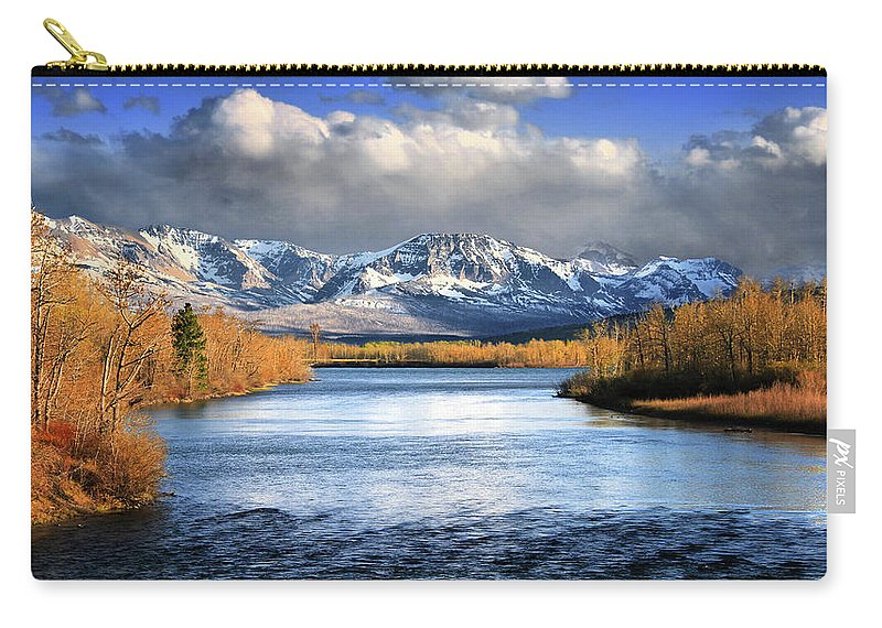 Glacier National Park Carry-all Pouch featuring the photograph Lined In Gold by Gary Yost