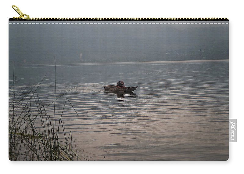 Lone Carry-all Pouch featuring the photograph Lone Fisherman Lake Atitlan by Douglas Barnett