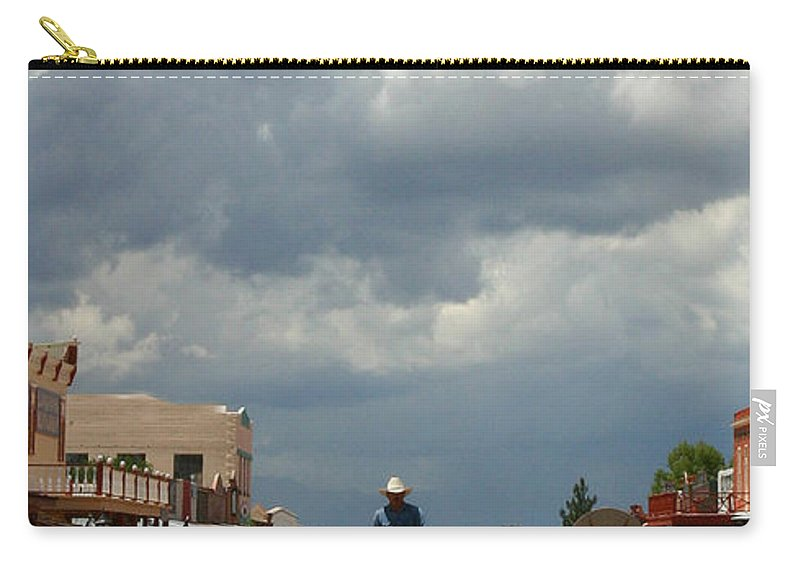 Arizona Carry-all Pouch featuring the photograph Lone Rider by Joe Kozlowski