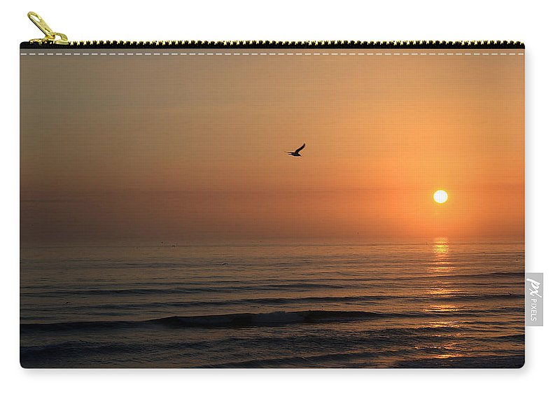 Bird Fly Flight Gull Alone Sun Sunrise Sky Ocean Wave Reflection Nature Golden Gold Carry-all Pouch featuring the photograph Lonely Flight by Andrei Shliakhau