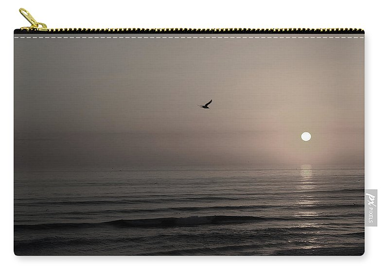 Beach Ocean Wave Sunrise Sunset Sun Bird Gull Fly Flight Water Vacation Peace Nature Relax Peace Carry-all Pouch featuring the photograph Lonely Flight II by Andrei Shliakhau