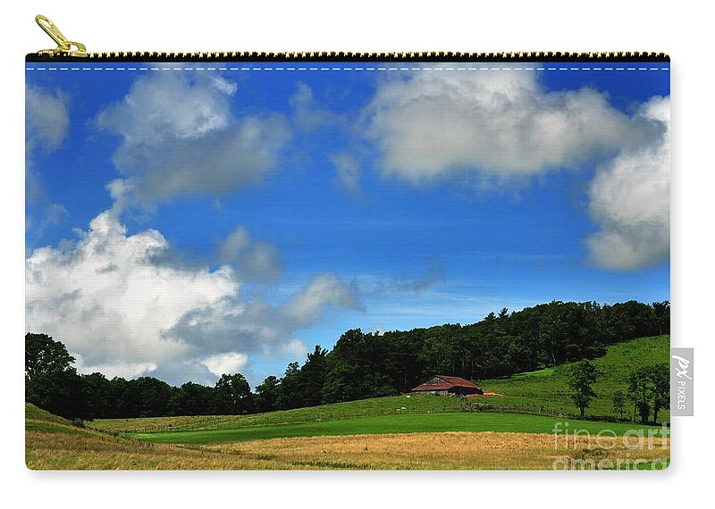Clouds Carry-all Pouch featuring the photograph Lonely Meadow by Eric Liller