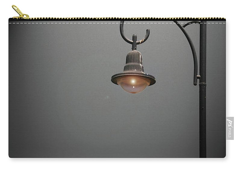 Street Carry-all Pouch featuring the photograph Lonely Street Light At Dark by Idan Badishi