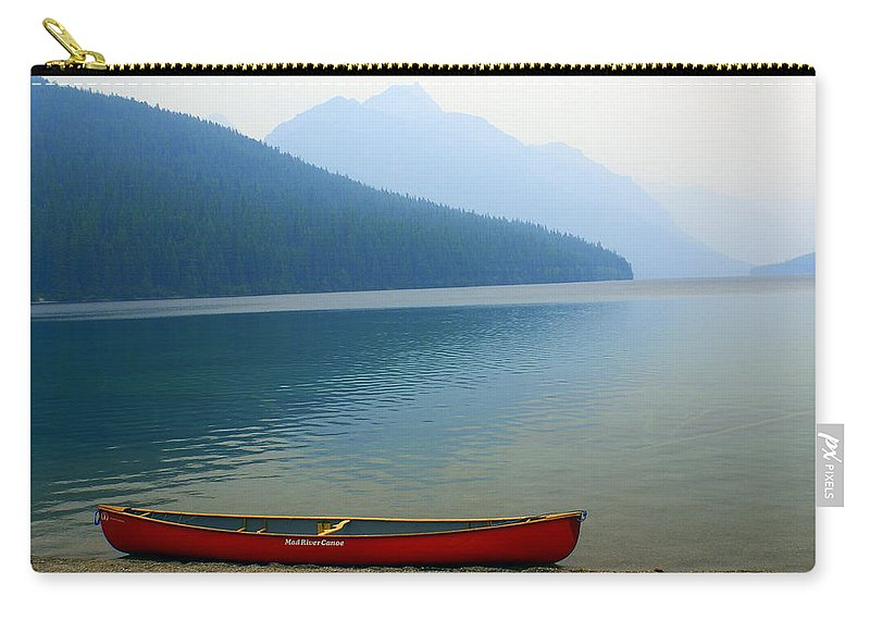 Glacier National Park Carry-all Pouch featuring the photograph Lonly Canoe by Marty Koch