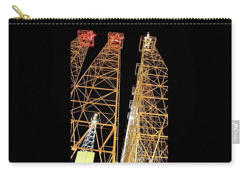 Kilgore Lighted Oil Derricks Carry-all Pouch featuring the photograph Looking Up At The Kilgore Lighted Derricks by Kathy White