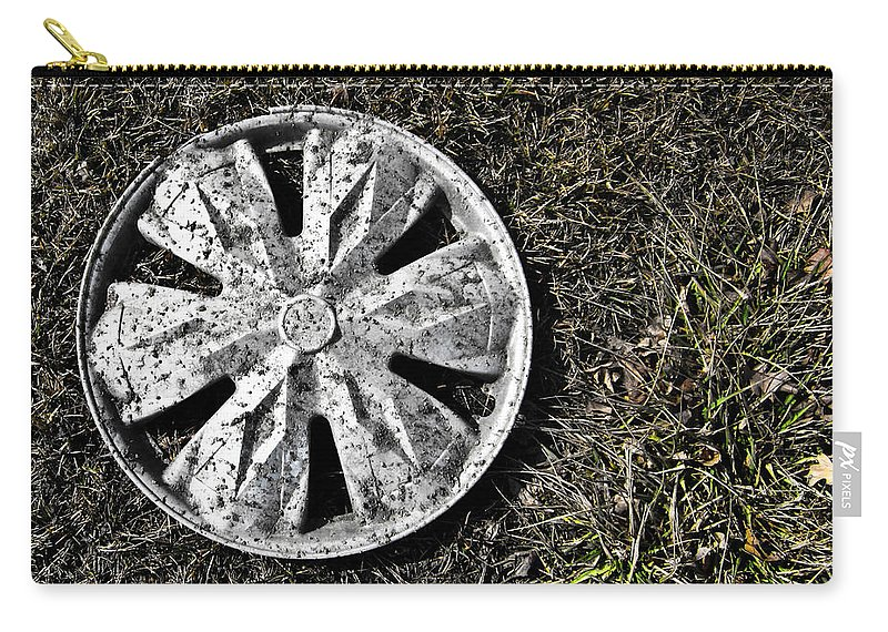 Hub Cap Carry-all Pouch featuring the photograph Lost Hub Cap by Angus Hooper Iii