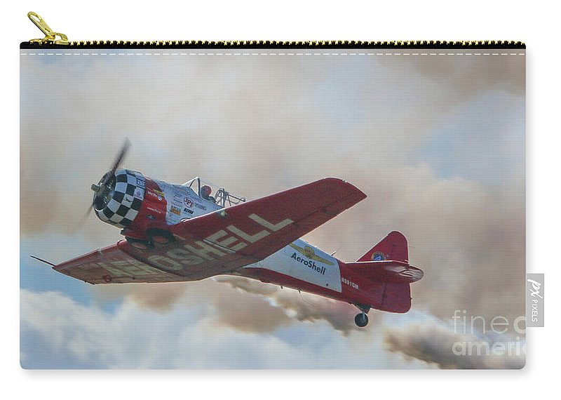 Plane Carry-all Pouch featuring the photograph Low Pass Stunt Plane by Tom Claud