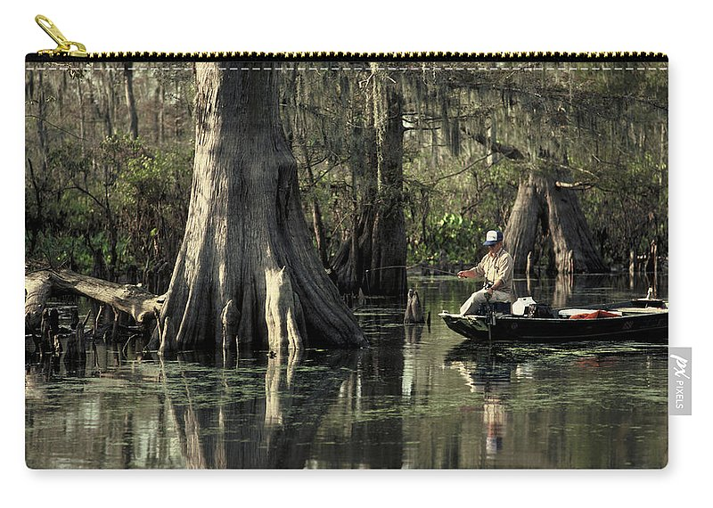 Fishing Carry-all Pouch featuring the photograph Man Fishing In Cypress Swamp by Herman Robert