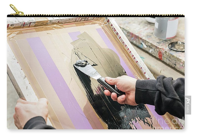 Paint Carry-all Pouch featuring the photograph Man Squeegeeing Silkscreen In A Workshop. Serigraphy by Michal Bednarek
