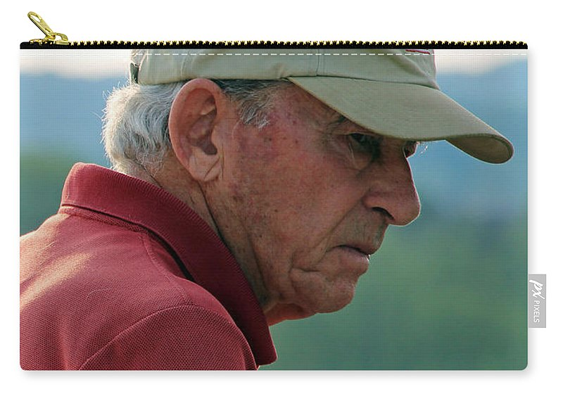 Man Carry-all Pouch featuring the photograph Man With American Flag On Cap by Cora Wandel