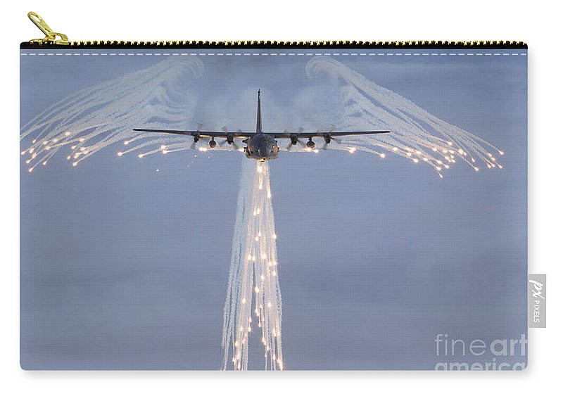 Mc-130 Carry-all Pouch featuring the photograph Mc-130h Combat Talon Dropping Flares by Gert Kromhout