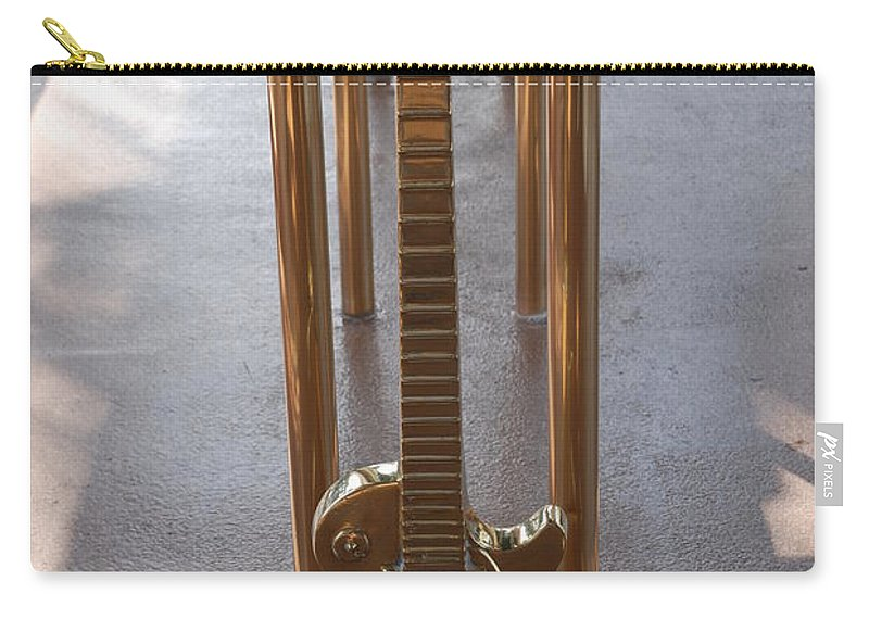 Brass Carry-all Pouch featuring the photograph Miami Hard Rock Brass Rail by Rob Hans