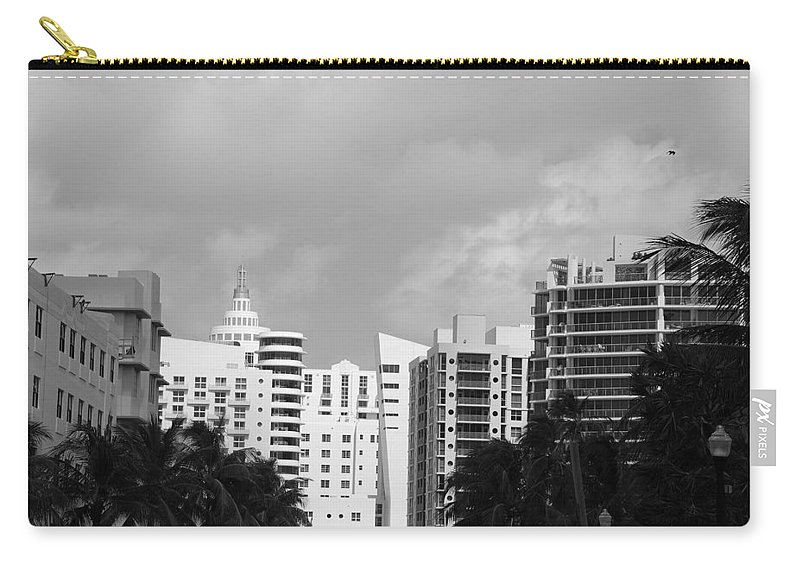 Black And White Carry-all Pouch featuring the photograph Miami Sky by Rob Hans