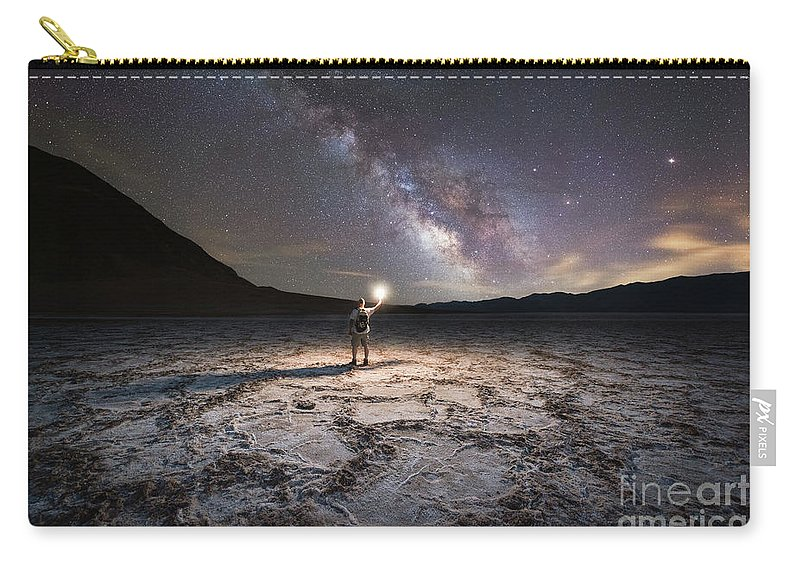 Badwater Basin Carry-all Pouch featuring the photograph Midnight Explorer At Badwater Basin by Michael Ver Sprill