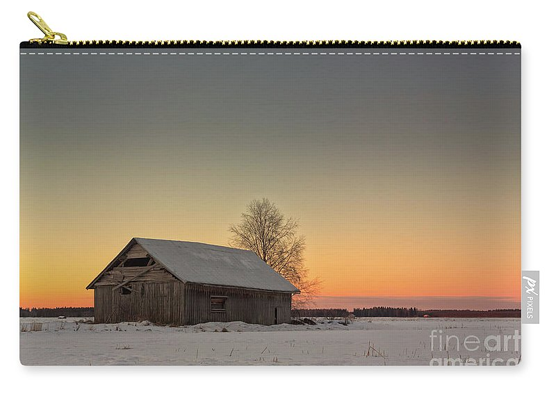 Copy Space Carry-all Pouch featuring the photograph Midwinter Sunset On The Fields by Jukka Heinovirta