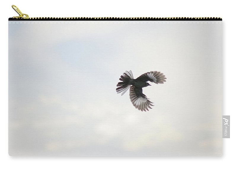 Mockingbird Carry-all Pouch featuring the photograph Mockingbird In Flight by Emily Shand