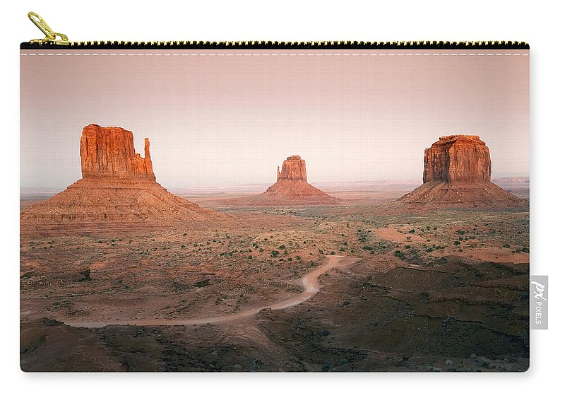 Dusk Carry-all Pouch featuring the photograph Monument Dusk by Mike Dawson