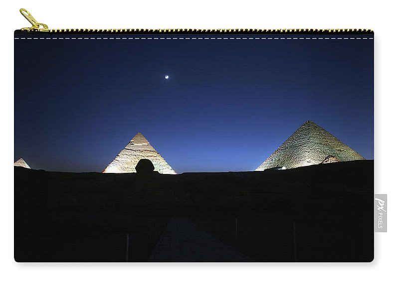Moonlight Carry-all Pouch featuring the photograph Moonlight Over 3 Pyramids by Donna Corless