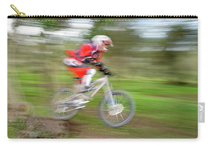 Mountain Carry-all Pouch featuring the photograph Mountain Bike Rider by Ilan Amihai