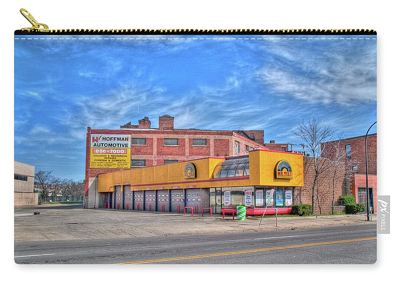 Buildings Carry-all Pouch featuring the photograph Mr Tire 15117 by Guy Whiteley