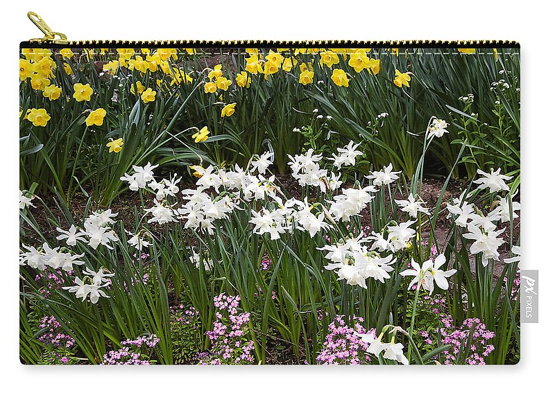Flower Carry-all Pouch featuring the photograph Narcissus And Daffodils In A Spring Flowerbed by Louise Heusinkveld
