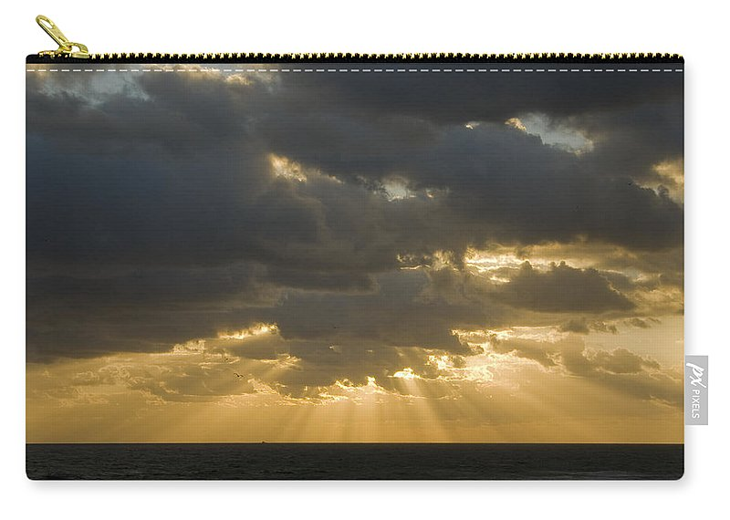 Ocean Sunset Sun Cloud Clouds Ray Rays Beam Beams Bright Wave Waves Water Sea Beach Golden Nature Carry-all Pouch featuring the photograph New Beginning by Andrei Shliakhau